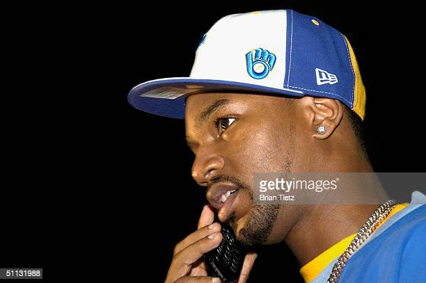 Cam'ron speaks on a mobile phone as he attends Tyson Vs Williams fight held at Freedom Hall July 30 2004 in Louisville Kentucky