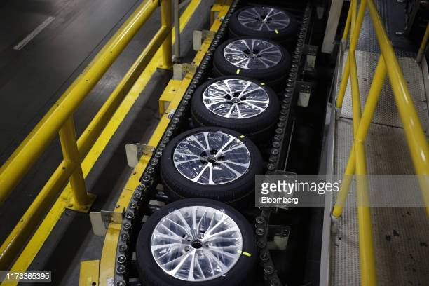 Camry vehicle wheels move down a conveyor belt at the company's manufacturing plant in Georgetown Kentucky US on Wednesday Aug 28 2019 Retrofitting a...