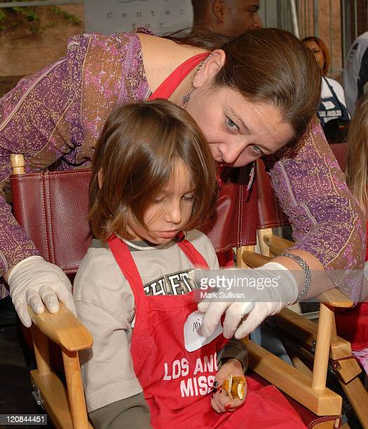 Camryn Manheim with son Milo during Los Angeles Mission's Christmas Meal For The Homeless December 23 2005 at Los Angeles Mission in Los Angeles...