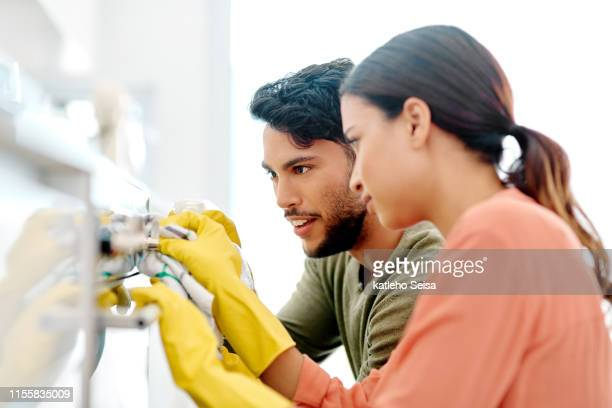 i can actually see my reflection! - washing up glove stock pictures, royalty-free photos & images