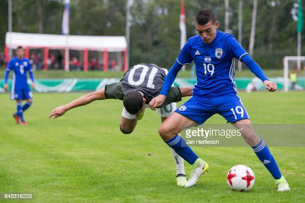 Can Bozdogan of Germany and Liran Cohen of Israel fight for the ball during the 'Four Nations Tournament' match between U17 Germany and U17 Israel on...