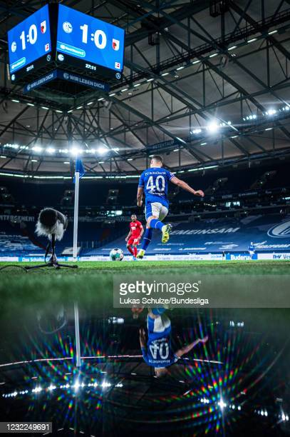 Can Bozdogan of Schalke kicks a corner during the Bundesliga match between FC Schalke 04 and FC Augsburg at Veltins-Arena on April 11, 2021 in...