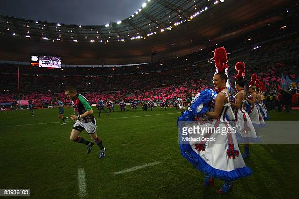 Can Can girls greet the Harlequin players as they run out of the tunnel for the Heineken Cup Pool Four match between Stade Francais and Harlequins at...