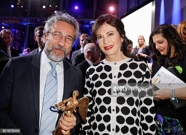 Can Duendar poses with his award for 'Freedom of the press' next to Iris Berben during the VDZ Publishers' Night 2016 at Deutsche Telekom's...