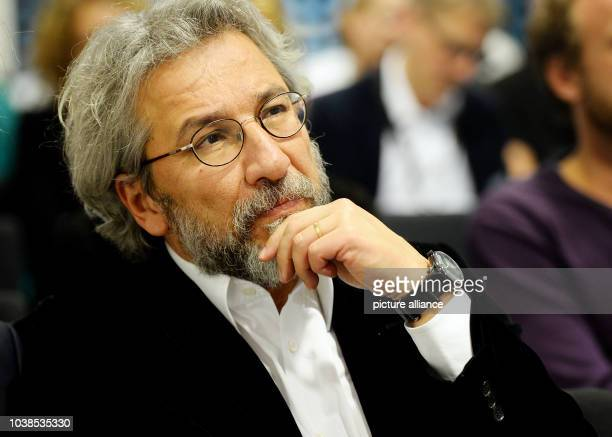 Can Dundar former editorinchief of the Turkish newspaper Cumhuriyet and Turkish government critic watches the 2016 Raif Badawi Awards ceremony at the...