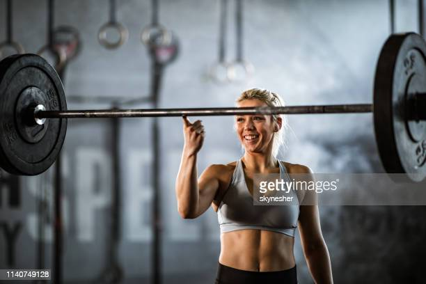 i can lift this barbell with my finger! - smooth stock pictures, royalty-free photos & images