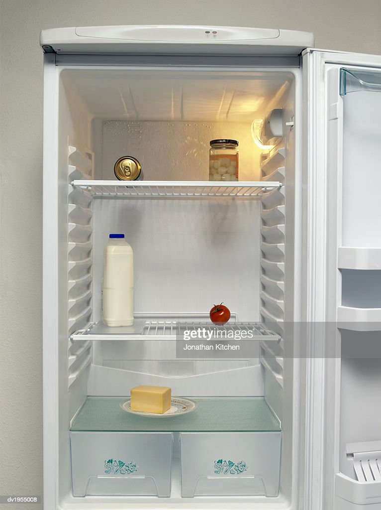 Can of Beer, Pickled Onions, Milk Bottle, Tomato and Butter on a Plate in a Fridge : Stock Photo