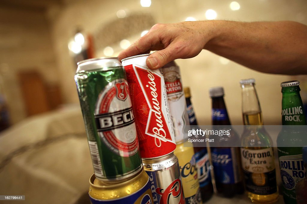 A can of Budweiser beer is displayed in a kiosk in Grand Central Terminal on February 27, 2013 in New York City. In a new class action lawsuit against Anheuser-Busch, beer enthusiasts have accused the company of watering down its Budweiser, Michelob and other beers. The suits, which were filed in Pennsylvania, California and other states, are seeking millions in damages for allegedly cheating customers out of the alcohol content stated on labels. Anheuser-Busch calls the suit groundless.