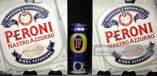 A can of Foster's lager produced by Foster's Group Ltd center sits alongside boxes of Peroni lager produced by SABMiller Plc in this arranged...