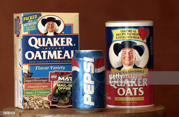 Can of Pepsi is shown in front of boxes of Quaker products August 2, 2001 in Boston MA. The Federal Trade Commission Wednesday decided to let...