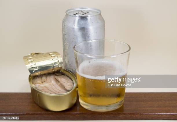 can of ventresca in olive oil, beer Can and glass of beer