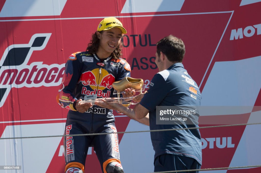 Can Oncu of Turkey celebrates the victory on the podium at the end of the Red Bull MotoGP Rookies Cup race 2 during the MotoGP Netherlands - Race on July 1, 2018 in Assen, Netherlands.