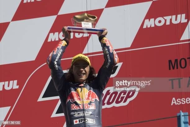 Can Oncu of Turkie celebrates the victory on the podium at the end of the Red Bull MotoGP Rookies Cup during the MotoGP Netherlands Qualifying on...