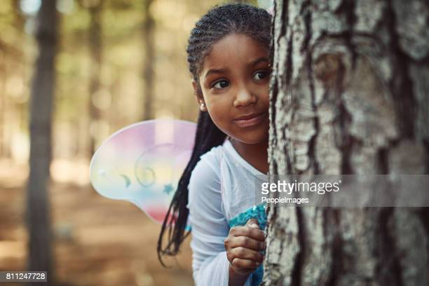can you spot a cute fairy in the forest? - fairy stock photos and pictures