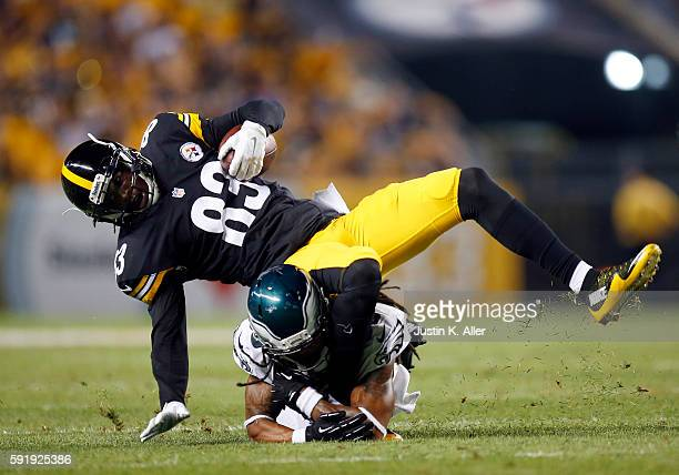 Canaan Severin of the Pittsburgh Steelers is tackled after making a catch by Jaylen Watkins of the Philadelphia Eagles during a preseason game on...