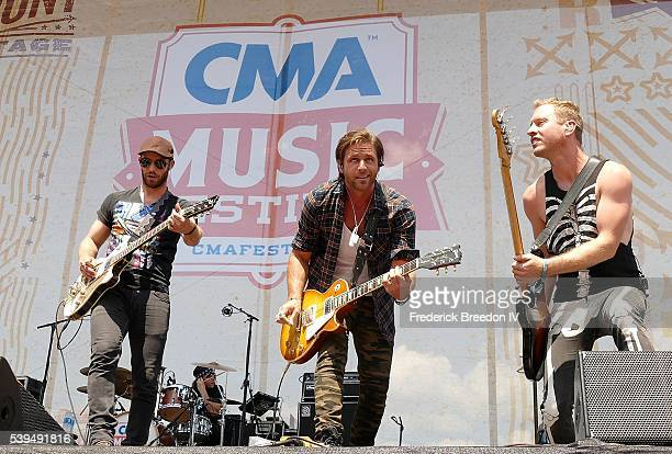 Canaan Smith center performs with his bandmates during the CMA Fest on the Chevrolet River Stage on June 11 2016
