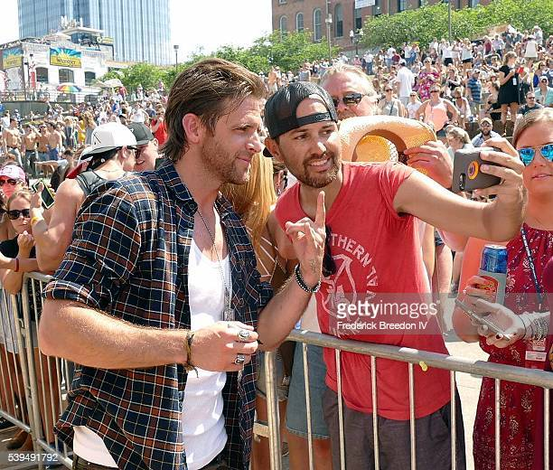 Canaan Smith poses for a photo with a fan during the CMA Fest after a performance on the Chevrolet River Stage on June 11 2016
