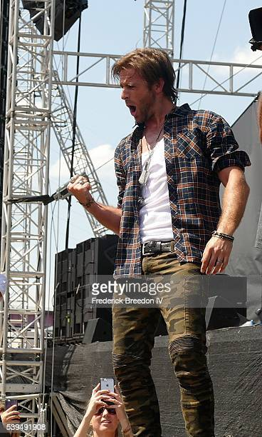 Canaan Smith pumps his fist during a performance during the CMA Fest on the Chevrolet River Stage on June 11 2016 in Nashville Tennessee