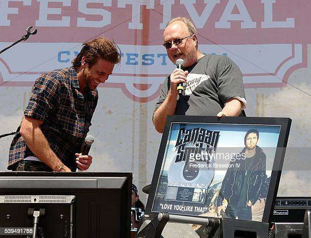Canaan Smith recieves a plaque for obtaining platinum status for his song Love You LIke That during a performance at the CMA Fest on the Chevrolet...