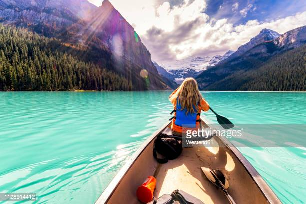 canada, alberta, banff national park, canoeing on lake louise - banff national park stock pictures, royalty-free photos & images