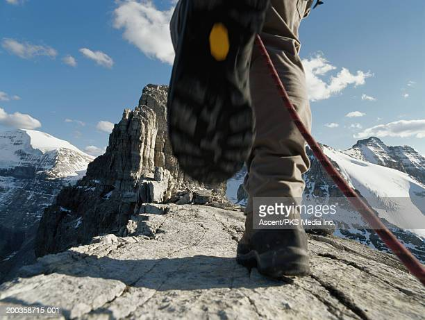 canada, alberta, banff np, mountaineer on ridge, low section - stepping stock pictures, royalty-free photos & images
