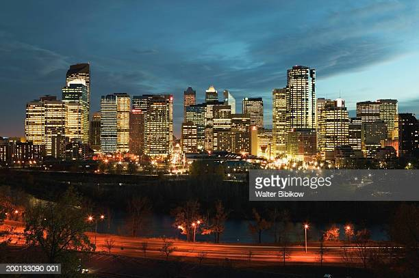canada, alberta, calgary, skyline, dusk - generic location stock pictures, royalty-free photos & images