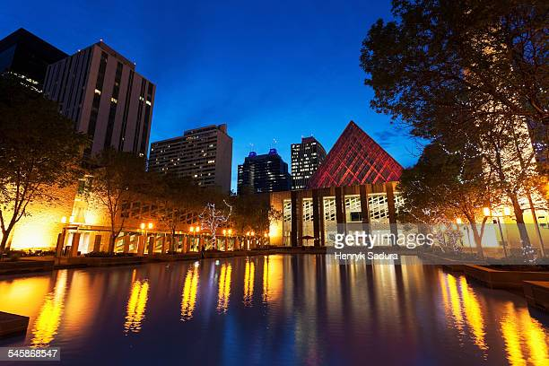 Canada, Alberta, Edmonton, Edmonton City Hall by pond at dusk