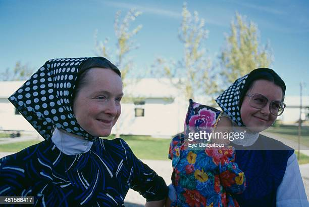 Canada Alberta Hutterite women and child from the Milford farming colony near Raymond Hutterites are a communal branch of Anabaptists forming male...