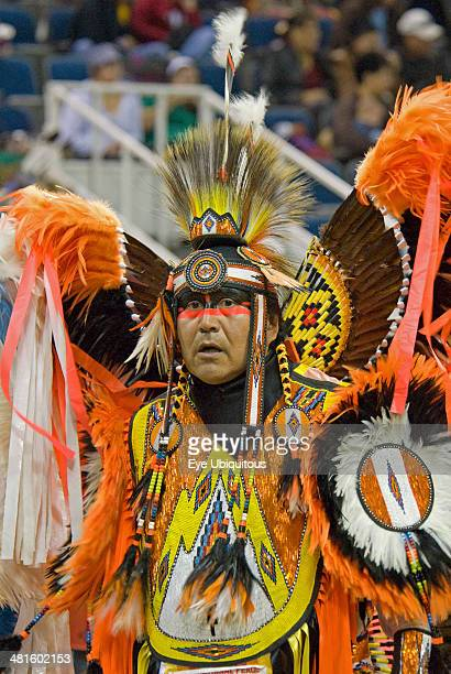 Canada Alberta Lethbridge International Peace Pow Wow Blackfeet Indian from Browning Montana in full costume with feather headdress and bustle...