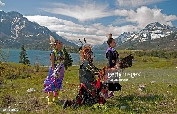 Canada Alberta Waterton Lakes National Park Blackfoot Indians dressed for a Pow Wow with Waterton Lakes Rocky Mountains and Prince of Wales Hotel in...