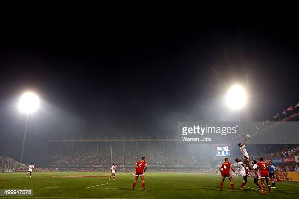Canada and Japan jump for the ball in the line out af BBQ smoke covers the pitch during the Emirates Dubai Rugby Sevens HSBC World Rugby Sevens...