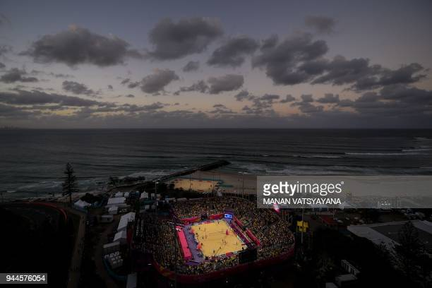 TOPSHOT Canada and New Zealand players compete during their men's beach volleyball semifinal match of the 2018 Gold Coast Commonwealth Games at the...