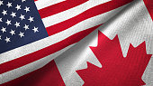 Canada and United States two flags together realations textile cloth fabric texture