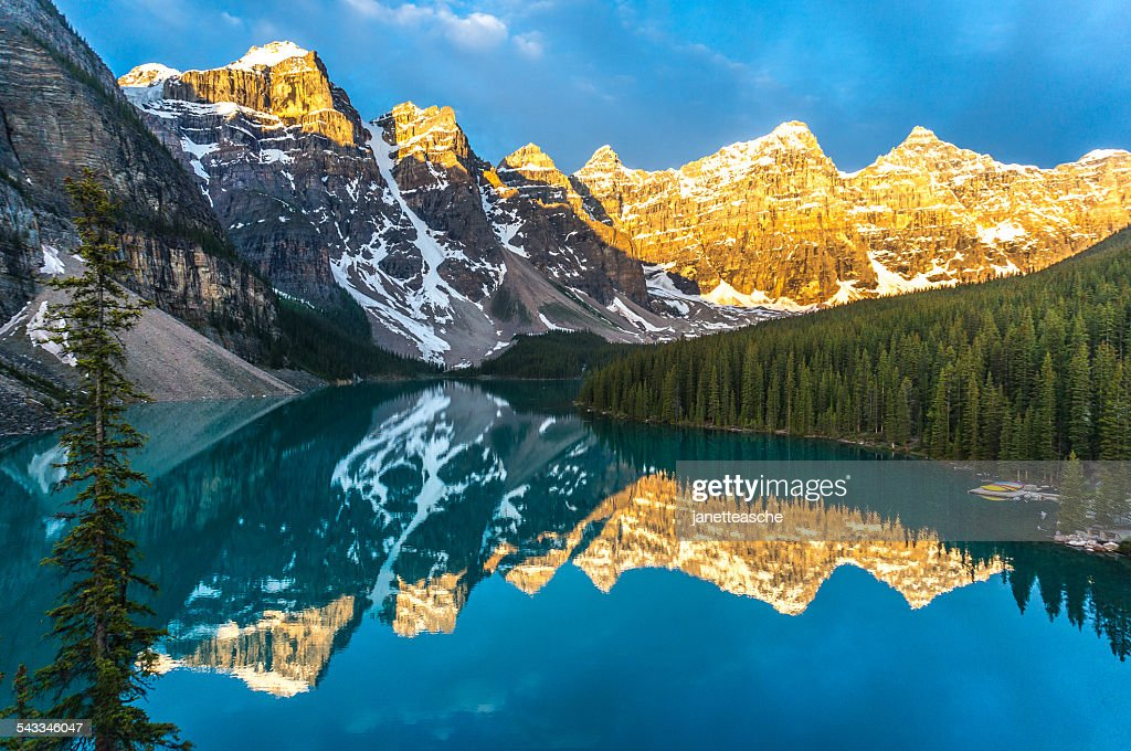 Canada, Banff National Park, Canadian Rockies, Mountains reflecting in calm lake at sunrise : Stock Photo