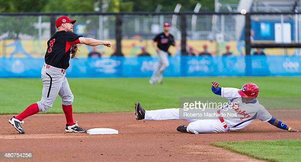 Canada baseball team beats Cuba 3-1: Raul Gonzalez slide in second base trying to break a double play by Canadian defensive.