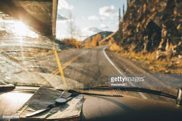 Canada, British Columbia, Alaska Highway, car with map and wrist watch