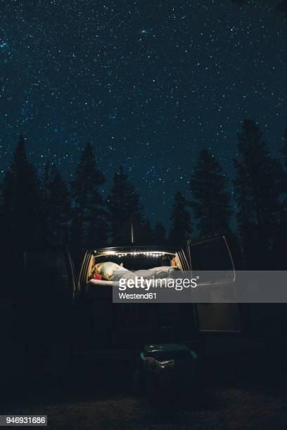 canada, british columbia, chilliwack, starry sky and illuminated minivan at night - minivan stock photos and pictures