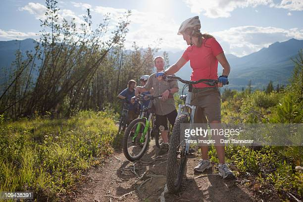 Canada, British Columbia, Fernie, Group of four friends enjoying mountain biking