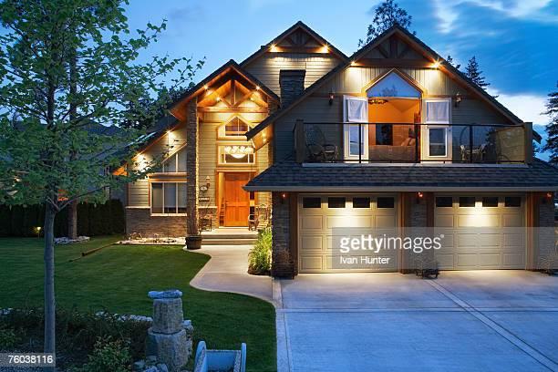 Canada, British Columbia, Kelowna, House exterior and driveway at dusk