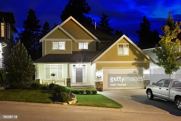 Canada, British Columbia, Kelowna, House exterior and driveway at night