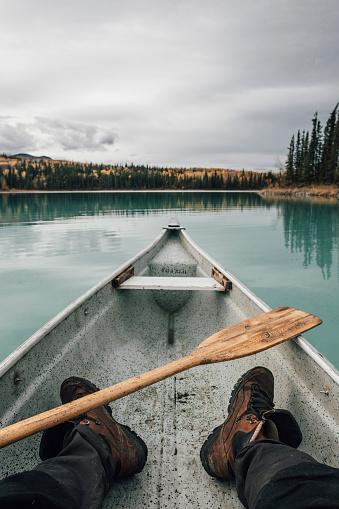 Canada, British Columbia, legs of a man in canoe on Boya Lake - gettyimageskorea