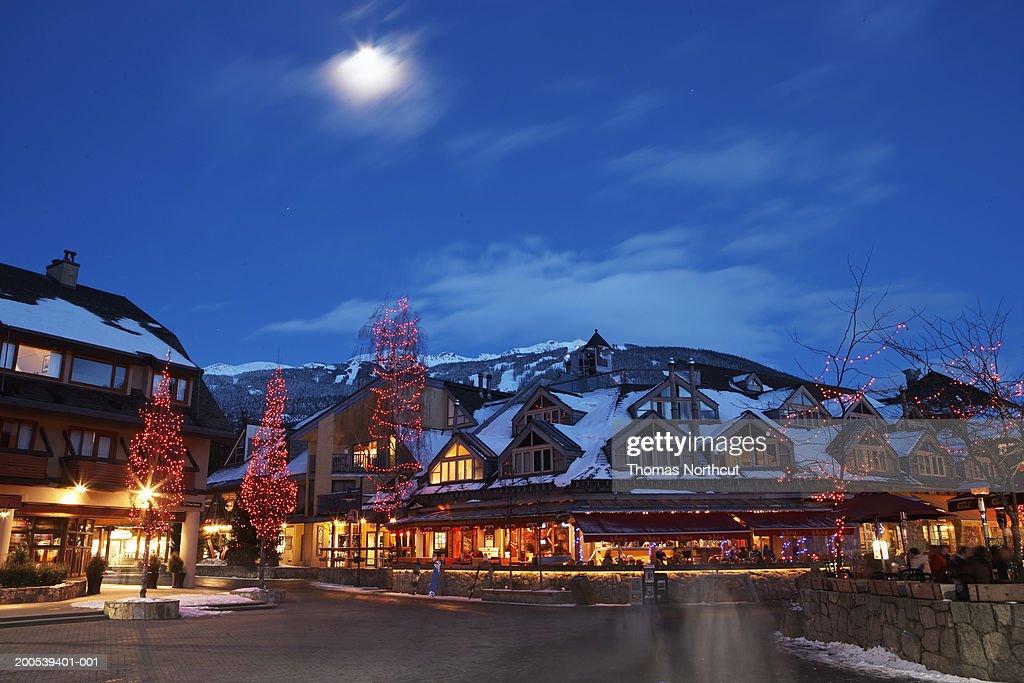 Canada, British Columbia, moon over Whistler Village at dusk : Stock Photo