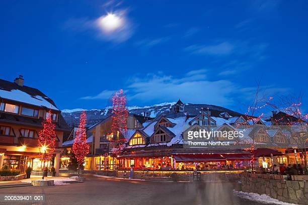 canada, british columbia, moon over whistler village at dusk - whistler british columbia stock pictures, royalty-free photos & images