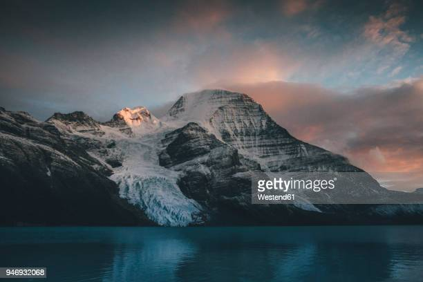 canada, british columbia, rocky mountains, mount robson provincial park, fraser-fort george h, berg lake, berg glacier, mist glacier - glacier lagoon stock photos and pictures