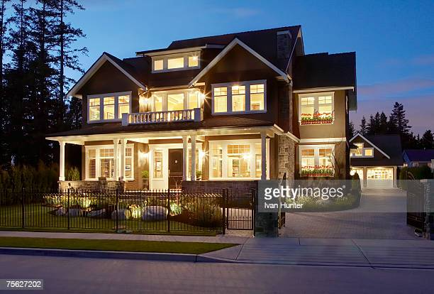 Canada, British Columbia, Surrey, front exterior of house illuminated at dusk (long exposure)