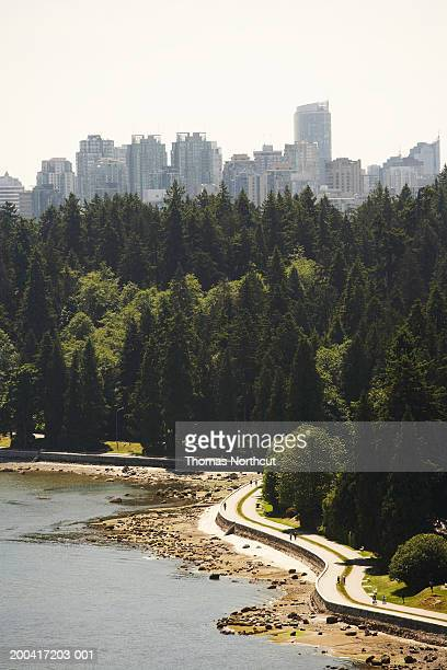 canada, british columbia, vancouver, stanley park and cityscape - stanley park stock photos and pictures
