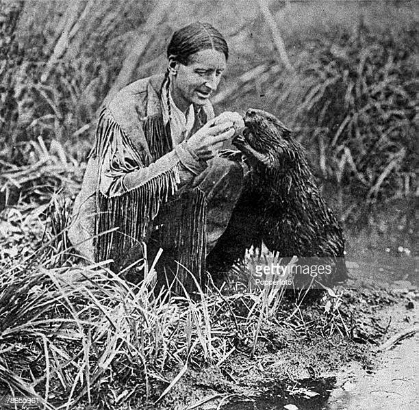 Canada A picture of Grey Owl a North American Indian feeding his pet Beaver Jellyroll