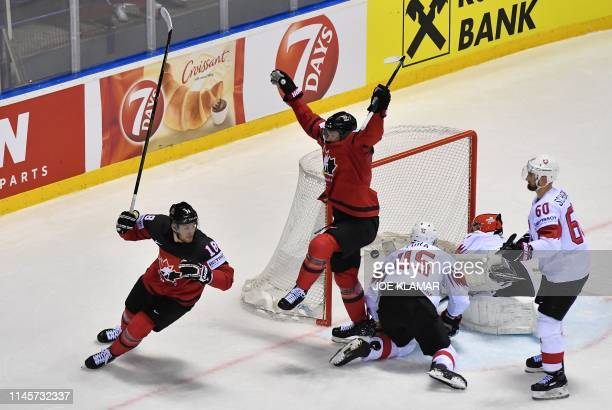 Canada celebrate a last second goal during the IIHF Men's Ice Hockey World Championships quarterfinal match between Canada and Switzerland on May 23...