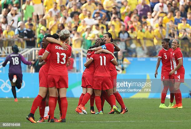 Canada celebrate after they defeated Brazil during the Women's Football Bronze Medal match between Brazil and Canada on Day 14 of the Rio 2016...