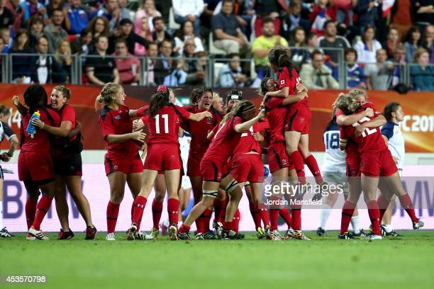 Canada celebrate as they win the IRB Women's Rugby World Cup semifinal match between France and Canada at Stade Jean Bouin on August 13 2014 in Paris...